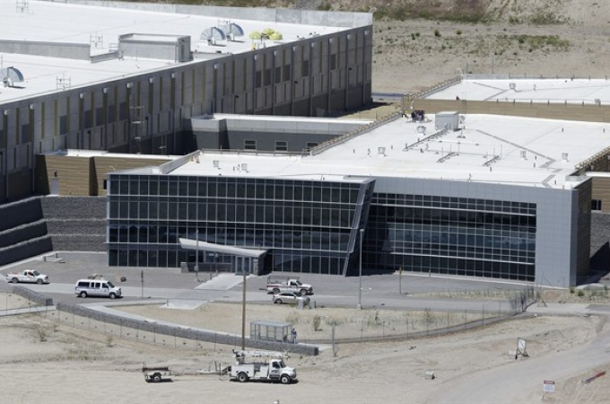 An aerial view of the NSA's Utah Data Center in Bluffdale, Utah, Thursday, June 6, 2013. The government is secretly collecting the telephone records of millions of U.S. customers of Verizon under a top-secret court order, according to the chairwoman of the Senate Intelligence Committee. The Obama administration is defending the National Security Agency's need to collect such records, but critics are calling it a huge over-reach. (AP Photo/Rick Bowmer)